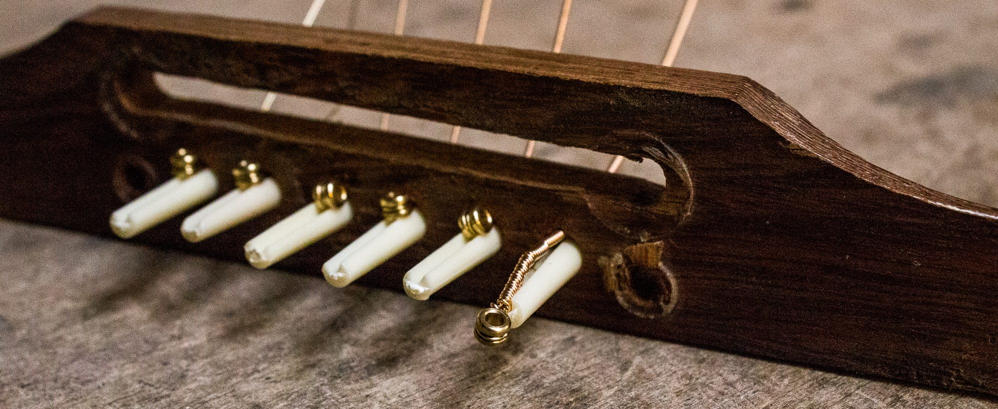 pinned down how to keep your bridge pins in your guitar strings direct. Black Bedroom Furniture Sets. Home Design Ideas