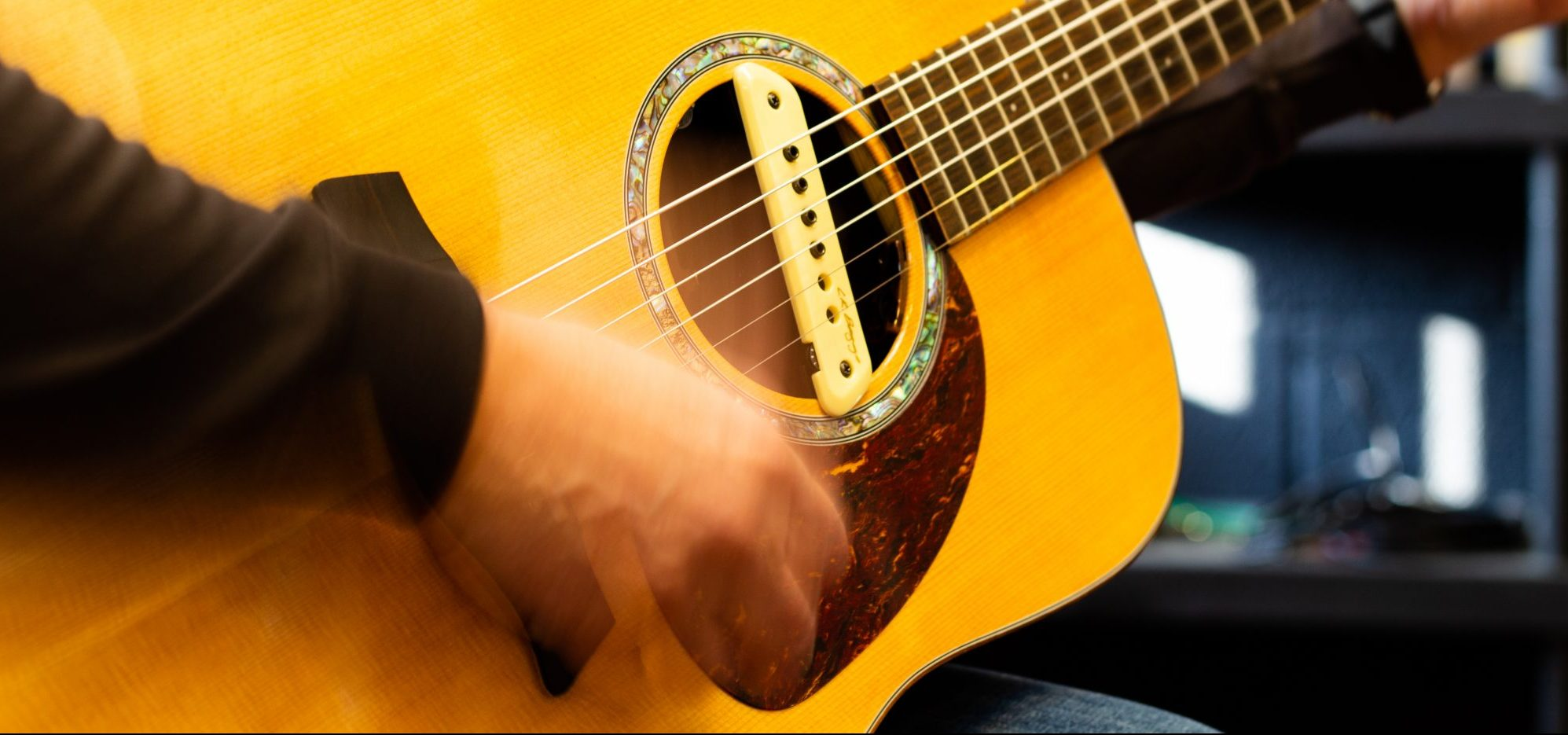 Acoustic guitar player with sound hole pickup
