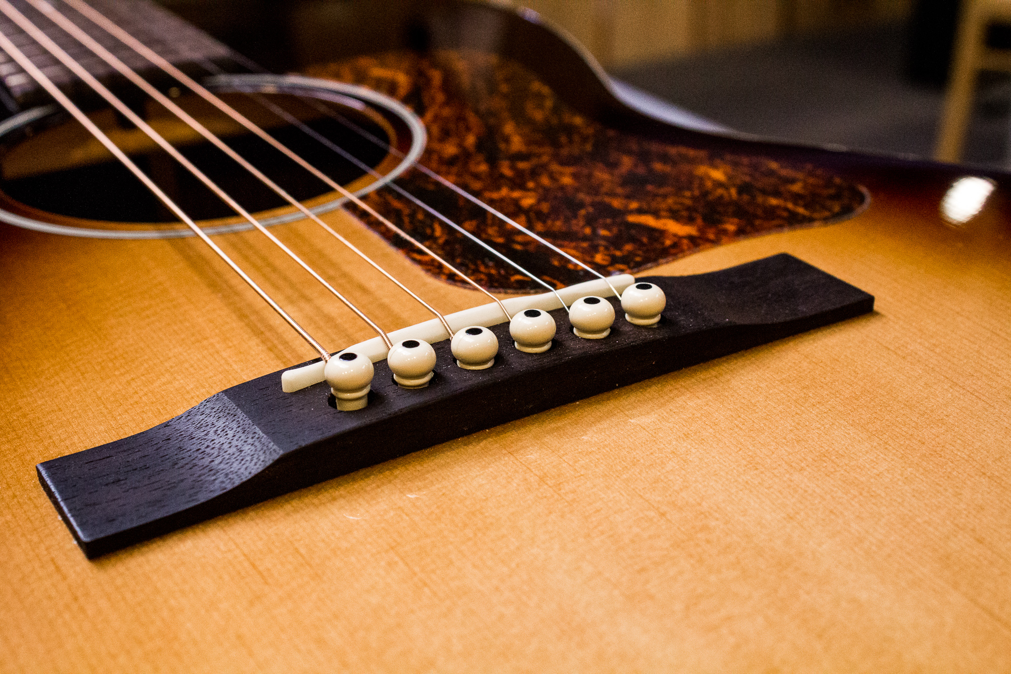 Pinned Down How To Keep Your Bridge Pins In Your Guitar Strings Direct