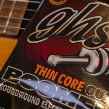 GHS Thin Core Set laying on a guitar